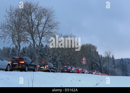 Schleiz, Germany, a traffic jam on a highway at dusk in winter - Stock Photo