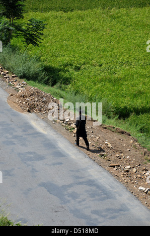 Policeman on road - Swat Valley, Pakistan - Stock Photo