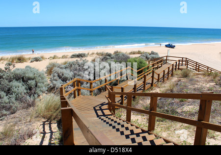 Wooden boardwalk leading down to the Indian Ocean at Buffalo beach  near Bunbury Western Australia  a  popular fishing - Stock Photo