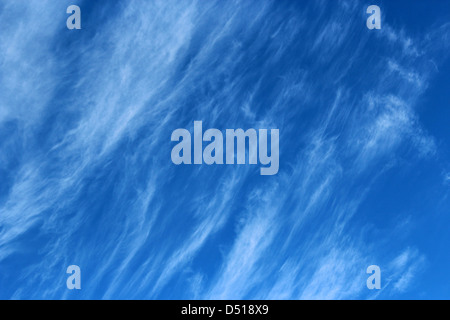 Fine high white  wispy cirrus clouds mare's tails  in a blue Australian sky herald a change to rain in a couple - Stock Photo