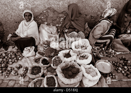 Woman selling vegetables and spices in the street, Jugol (Old Town) Harar, Ethiopia - Stock Photo
