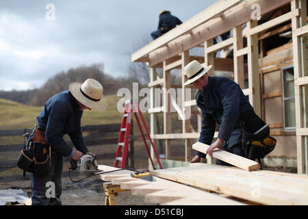 Dec 05, 2012 - Bergholz, Ohio, U.S. - Men work on an addition to the barn at the Mullet farmhouse outside Bergholz, - Stock Photo