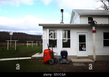 Dec 05, 2012 - Bergholz, Ohio, U.S. - Two young Amish children wait for the mother at the Mullet farmhouse outside - Stock Photo