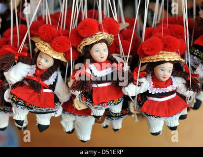 A file picture dated 5 August 2009 shows puppets with the traditional Black Forest Bollenhut hat at a souvenir shop - Stock Photo