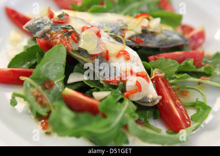 Roquette and tomato Salad and fried mackerel - Stock Photo