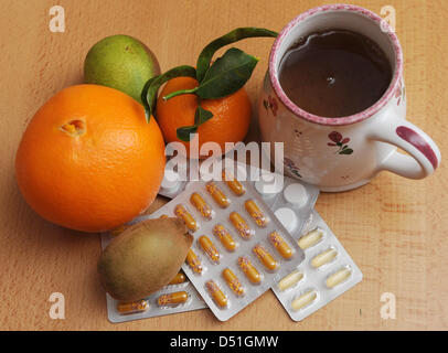 Tea, fruits, pills and vitamins are popular means of fighting a cold, pictured in Berlin, Germany, 09 December 2010. - Stock Photo