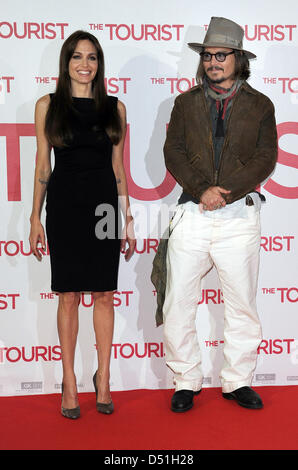 US actors Angelina Jolie (L) and Johnny Depp (R) attend the photocall for the German premiere of their new film - Stock Photo