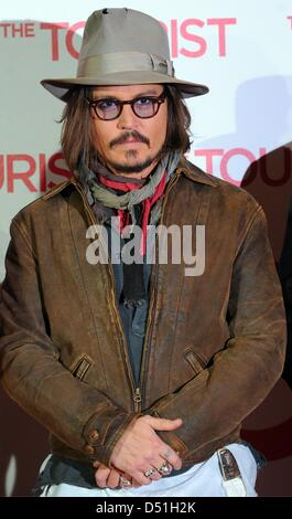 US actor Johnny Depp attends the photocall for the German premiere of his new film 'The Tourist' at Adlon hotel - Stock Photo