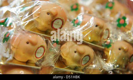 Pigs made of marzipan are stacked in the shop 'Niederegger-Marzipan' in Luebeck, Germany, 15 December 2010. Pigs, - Stock Photo