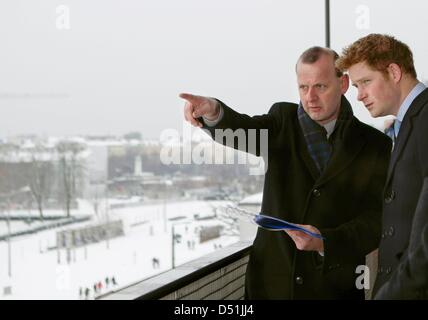 Britain's Prince Harry (R) listens to Axel Klausmeier, head of the Berlin Wall memorial fund, as they visit the - Stock Photo