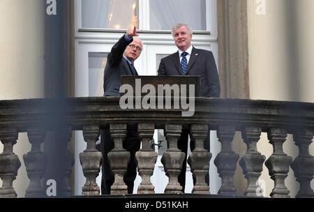 Bavarian Prime Minister Horst Seehofer (R)and German Ambassador to Czech Republic, Johannes Haindl stand on the - Stock Photo