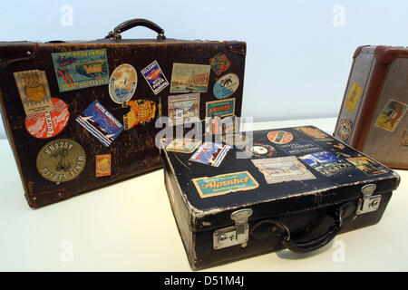 Suitcases bearing souvenir stickers are on display at a suitcase exhibition at the German National Museum in Nuremberg, - Stock Photo