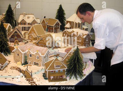 Jochen Hess, sous-chef of the luxury hotel Four Seasons, make a gingerbread village that is supposed to be exhibited - Stock Photo