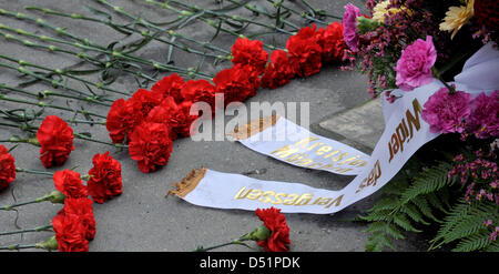 Flowers lie at the memorial for the victims of the Oktoberfest assassination on 26 September 1980 on the 30th centenary - Stock Photo