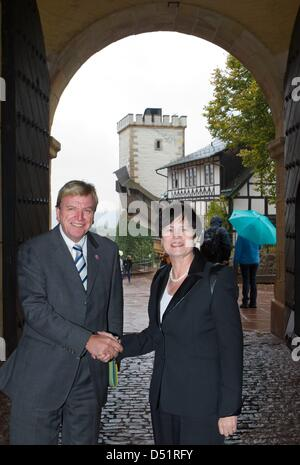 HessianPrime Minister Volker Bouffier (L)and Thuringian Prime Minister Christine Lieberknecht (R)shake hands - Stock Photo