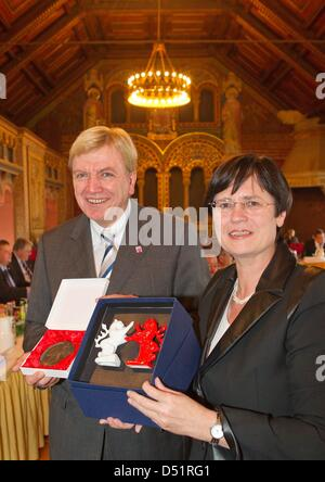 HessianPrime Minister Volker Bouffier (L)and Thuringian Prime Minister Christine Lieberknecht (R)smile with presents - Stock Photo