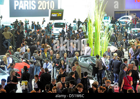 Visitors crowd at the booth of Renault during the 2010 Paris Motor Show in Paris, France, 30 September 2010. Some - Stock Photo