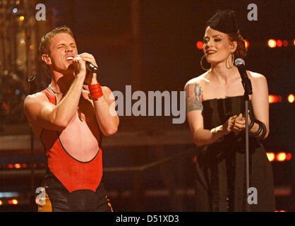 The singers of the American pop band 'Scissor Sisters', Jake Shears (l) and Ana Matronic, appear on stage during - Stock Photo