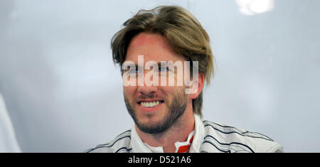 German formula one driver Nick Heidfeld of Team  Sauber smiles in the driver's pit at the Suzuka Circuit in Suzuka, - Stock Photo