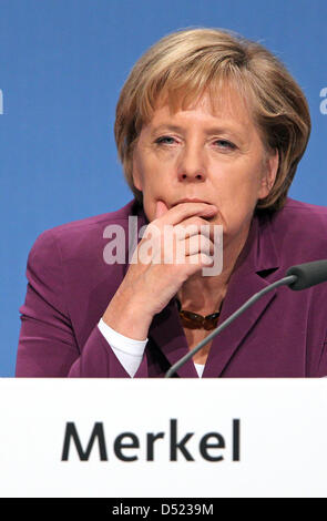 German Chancellor Angela Merkel sits in a regional conference of the CDU in Halle, Germany, 13 October 2010. The - Stock Photo