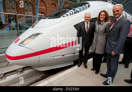 Deutsche Bahn CEO Ruediger Grube (L), state secretary of the British Transport Ministry Theresa Villiers (C) and - Stock Photo