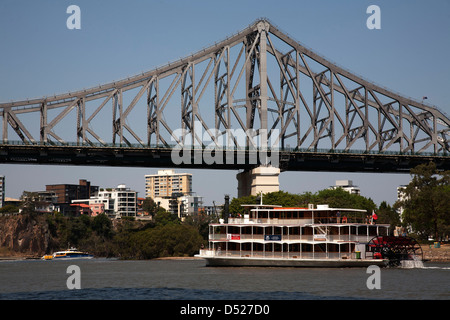 Tourist Paddle Boat on the Brisbane River passing under the Storey Brisbane Queensland Australia - Stock Photo