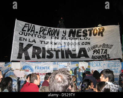 Thousands of people shared their sorrow over the death of former president Nestor Kirchner during an announcement - Stock Photo