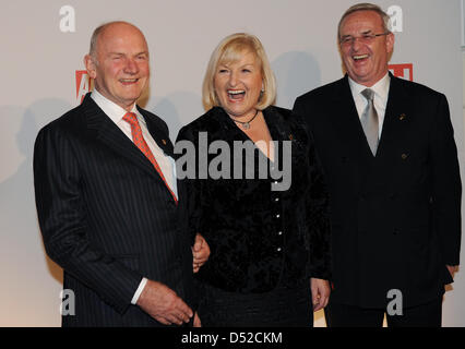 Ferdinand Piech (L), Chairman of the steering committee of car manufacturer Volkswagen Ag, his wife Ursula (C) and - Stock Photo