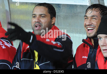 Former Bundesliga topscorer Ailton (L) sits on the bench of KFC Uerdingen at the 'Grotenburg Kampfbahn' in Krefeld, - Stock Photo