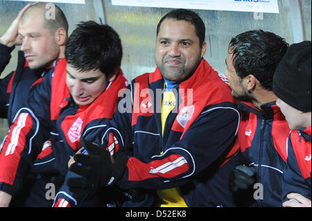 Former Bundesliga topscorer Ailton (2-R) sits on the bench of KFC Uerdingen at the 'Grotenburg Kampfbahn' in Krefeld, - Stock Photo