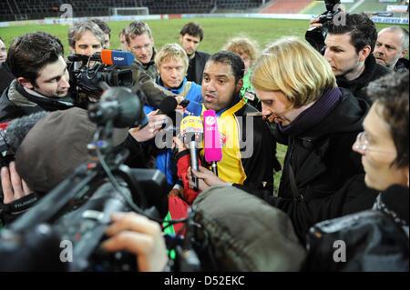 Uerdingen's former Bundesliga topscorer Ailton (C) is interviewed by journalists after his debut match KFC Uerdingen - Stock Photo