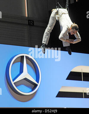 An artist hangs over the Mercedes logo during a Mercedes presentation on the first press day at the Geneva Motor - Stock Photo