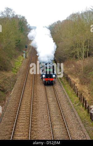 Reigate, Surrey, UK. 22nd March 2013. The British Pullman VS Orient Express Steam Locomotive SR Merchant Navy Clan - Stock Photo