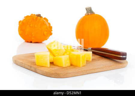 sliced pumpkin, ready for cooking. isolated on white - Stock Photo