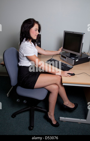 Secretary With Long Legs And Short Skirt Sitting At A Desk