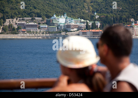 Karyes, Greece, tourists visit during a boat trip the Autonomous Moenchsrepublik Athos - Stock Photo