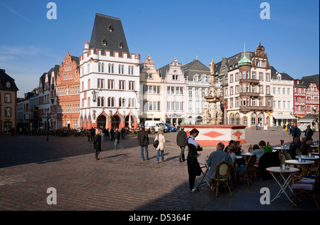 Trier, Germany, the main market of Trier with Petrusbrunnen and Steipe - Stock Photo