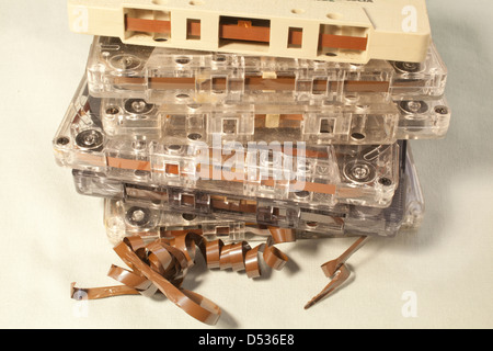 A pile of old cassette tapes. - Stock Photo