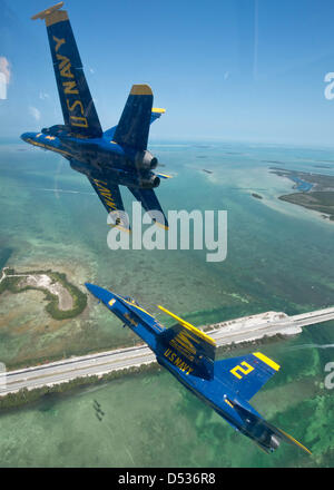 The US Navy flight demonstration squadron known as the Blue Angels fly in formation over the Florida Keys during - Stock Photo