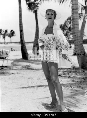 A fashion model in swimsuit poses at Matheson Hammock Park beach: Miami, Florida - Stock Photo