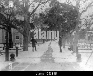 Men with snowballs: Pensacola Navy Yard - Stock Photo