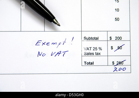Detail from an invoice with the total amount changed because incorrect VAT, exempt. - Stock Photo