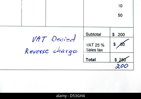Detail from an invoice with the total amount changed because incorrect VAT, reverse charge. - Stock Photo
