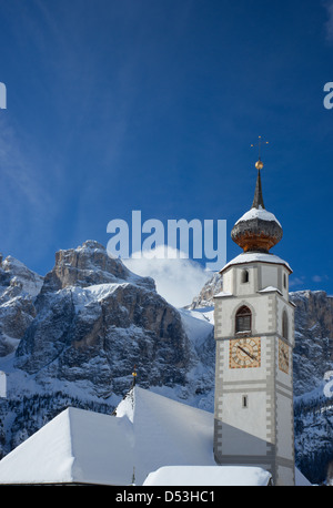 A church in Colfosco in Badia in front of the Sella Massiff mountain range in the Dolomites in the South Tyrol, - Stock Photo