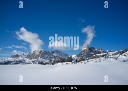 Sassongher Mountain seen from the snow covered Alta Badia ski resort, The Dolomites, South Tyrol, Italy - Stock Photo