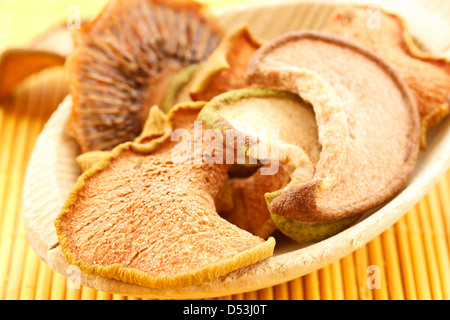 dried fruit in a large wooden spoon - Stock Photo