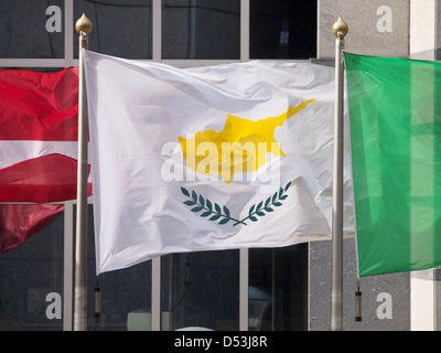 Flag of Cyprus waving in front of the EU parliament building in Brussels. - Stock Photo