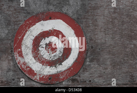 Picture of a red and white target on a wooden board - Stock Photo