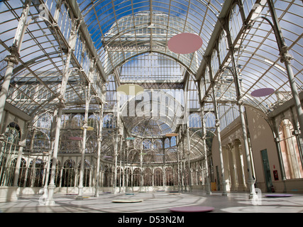 Madrid - Palacio de Cristal or Crystal Palace in Buen Retiro park - Stock Photo
