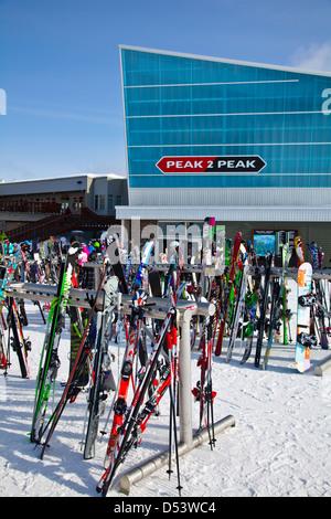 Ski racks by the Peak2Peak gondola between Blackcomb and Whistler mountains - Stock Photo